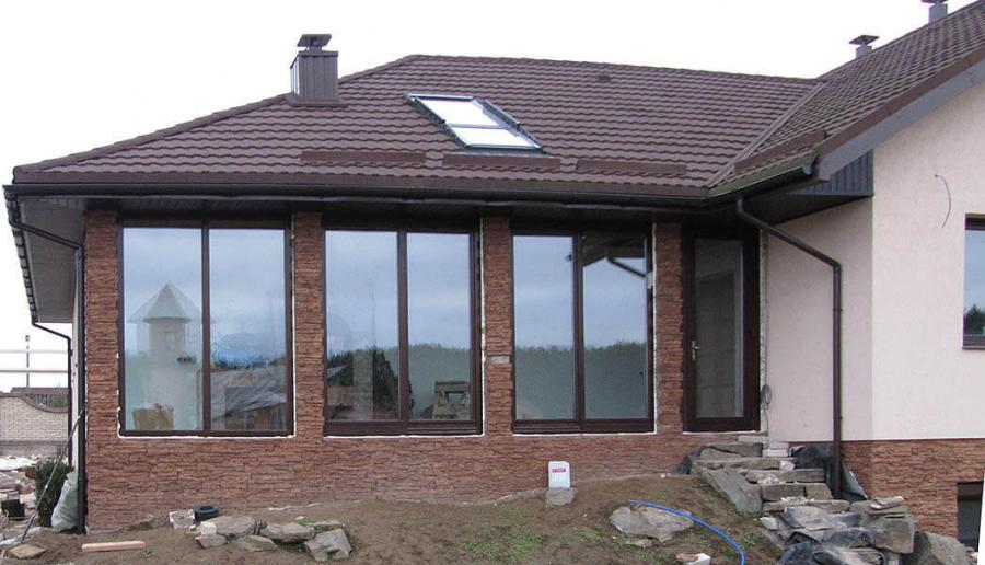 house-with-patio-and-roo-windows-front